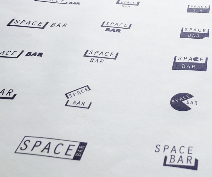 a sheet of paper with logo ideas printed on it